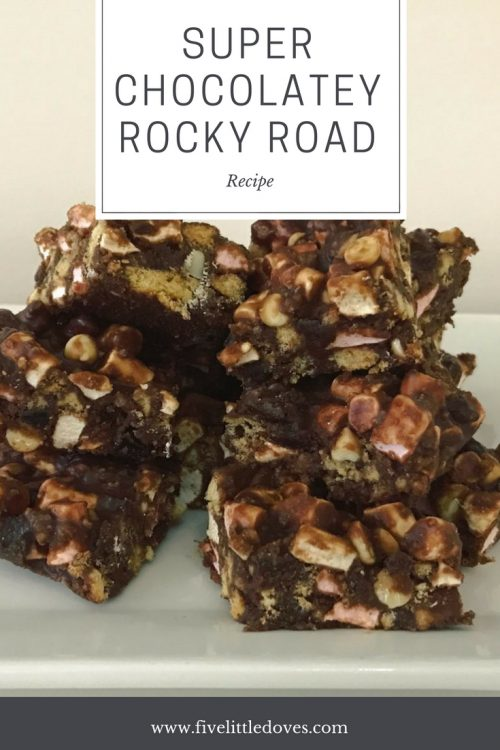 Super Chocolatey Rocky Road | A quick and easy family friendly recipe that is fun for baking with the kids. Lots of chocolate, syrup and marshmallows to make a sticky tray bake that everyone will love www.fivelittledoves.com