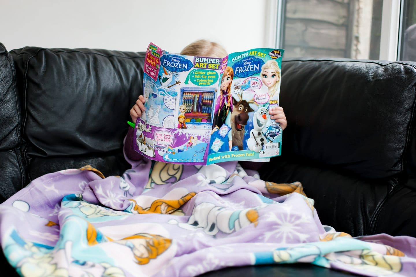 eva-on-the-couch-reading-magazine
