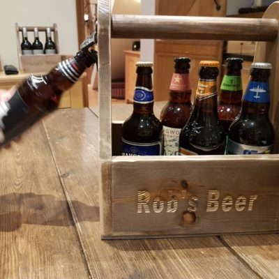 ** Win**  A personalised rustic beer caddy from Ligneus